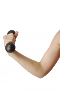 Boy's arm with dumbbell